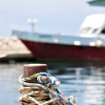 Marine rope on mooring bollard in port — Stock Photo #35937641