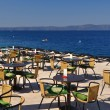 Tables and chairs of restaurant in beach of Podgora. Croatia — Stock Photo