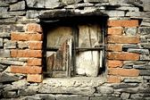 Old devastated window in stonewall — Foto Stock