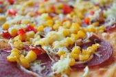 Detail of delicious pizza with corn and salami — Stock Photo