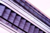 Abstract view of moving purple escalators — Stock Photo