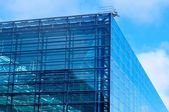 Abstract view of modern blue glass business center — Stock Photo