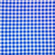 Stock Photo: Blue plaid fabric as background