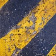 Stockfoto: Yellow and black warning sign on asphalt texture
