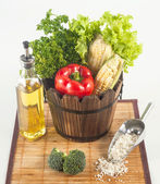 Fresh vegetables and other raw material set on a bamboo mat — Stock Photo