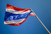 Image of waving Thai flag of Thailand with blue sky background — Foto Stock