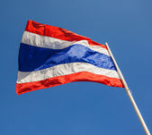 Image of waving Thai flag of Thailand with blue sky background — Стоковое фото
