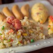 Stock Photo: Bacon fried rice with omelet and sausage and pizza