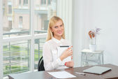 Confidence in business. Cheerful businesswoman working on the ta — Stock Photo