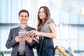 Businesspeople solve problems on the tablet. — Stock Photo