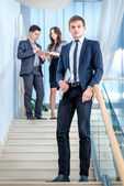Businesspeople on the stairs — Stock Photo