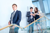 Three businessman standing on the stairs — Stock Photo