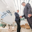 Two young businessmen shake their hands — Stock Photo #47620249