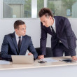 Two successful businessmen  talking in office — Stock Photo #47622113