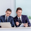 Two successful businessmen talking in office — Stock Photo