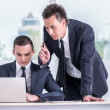 Two businessmen working on computer — Stock Photo #47623837