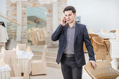 Businessman  talking on the cell phone — Stock Photo
