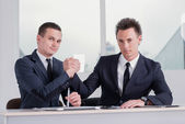 Two businessmen shake their hands — Stock Photo