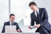 Two businessmen working on the laptop and tablet — Stock Photo