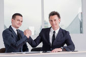 Businessmen shake their hands. — Stock Photo