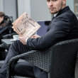 Portrait of a bearded businessman with a newspaper — Stock Photo #47835121