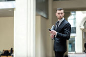 To meet clients. Confident businessman with laptop goes ahead an — Stock Photo