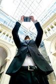 Businessman photographs business center — Stock Photo