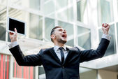 Incredible luck. Happy businessman celebrates his success. young — Foto de Stock