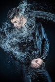 Man  in water splash — Stock Photo