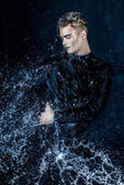 Man  in water splash — Stock Photo