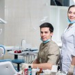 Постер, плакат: Two dentists working in a dental office