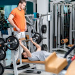 Strength training in the gym. Two young men are engaged in sport — Stock Photo #47955941