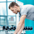 Load on the biceps. Successful athlete working out with dumbbell — Stock Photo #47956763