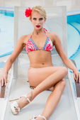 Woman in swimsuit on the sunbed — Stock Photo
