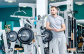 Athletic morning. A handsome man with a beard standing near the  — Stock Photo