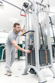 More weight. Confident athlete trainer weight loads. A young man — Stock Photo