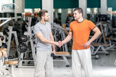 Hello athletes. Hello two athletes at the fitness club. Two beau — Stock Photo