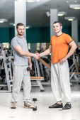 Hello athletes. Two athletes shake hands at the fitness club. Tw — Stock Photo