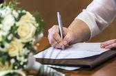 Bride signing — Stock Photo