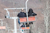 Couple on the chairlift — Zdjęcie stockowe