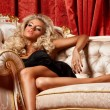 Blond on a sofa — Stock Photo