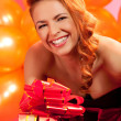 Woman with gift — Stock Photo #34692097