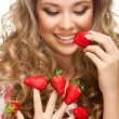 Girl with strawberries — Stock Photo