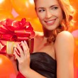 Woman with gift — Stock Photo #34692461