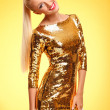 Stock Photo: Gold dress