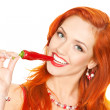 Redhead woman with chili pepper — Stock Photo #34692879