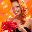 Woman with gift — Stock Photo #34693107