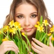 Girl and daffodils — Stock Photo
