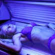 Blondy in solarium — Stock Photo