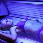 Blondy in solarium — Stock Photo